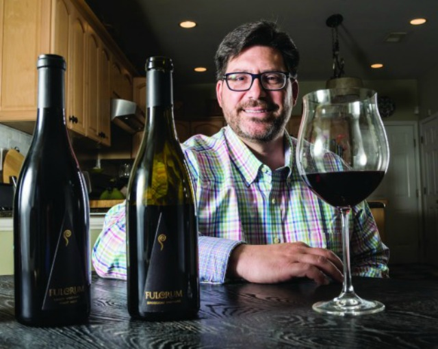 #516366- David Rossi, winemaker and owner of the Fulcrum brand wines in Napa Valley California in his home, Atlantic Highlands, NJ. David commutes from Atlantic Highlands to California to run his business. He is producing highly regarded Pinot Noir.